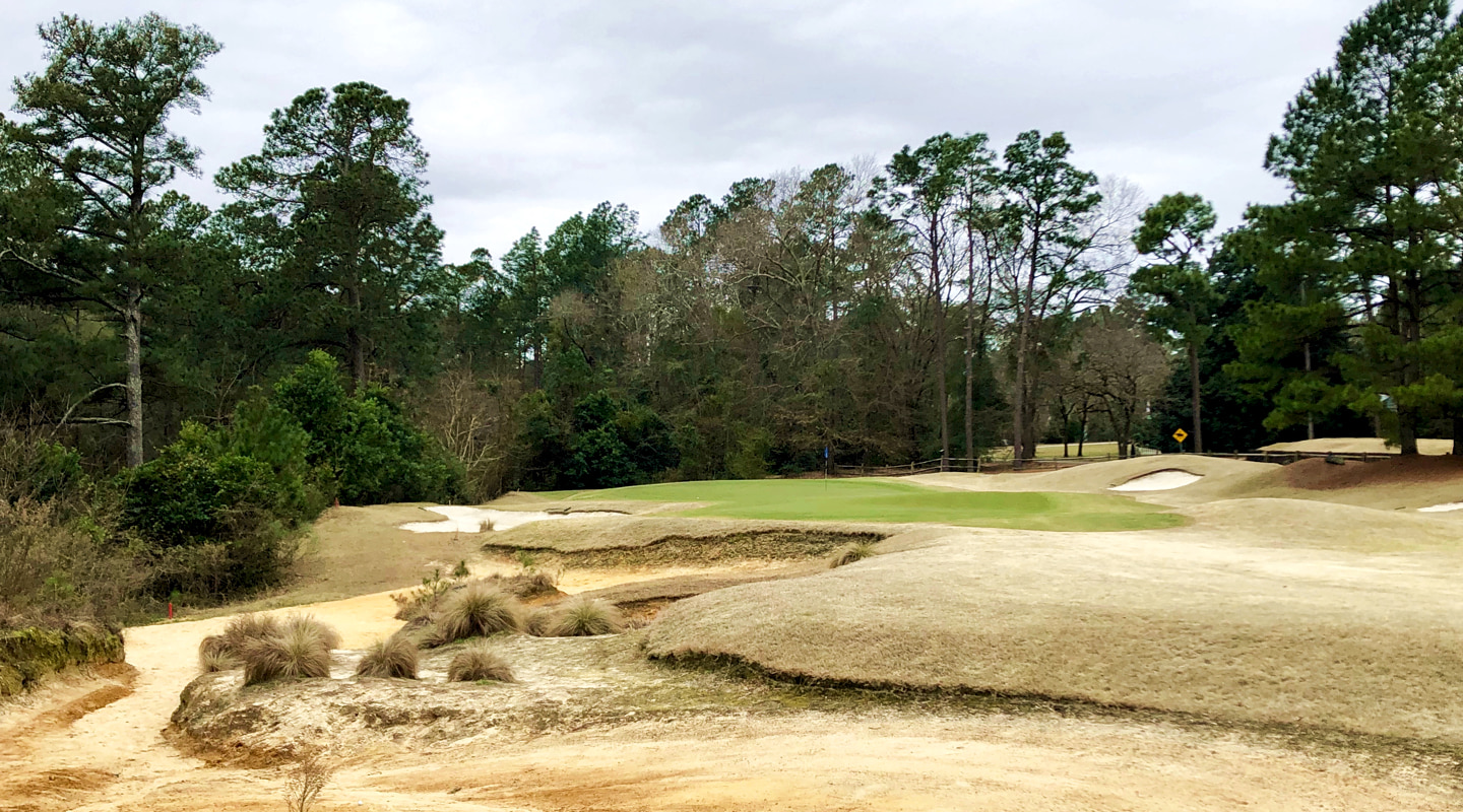 A restored sandy waste runs along the left of the par-5 5th