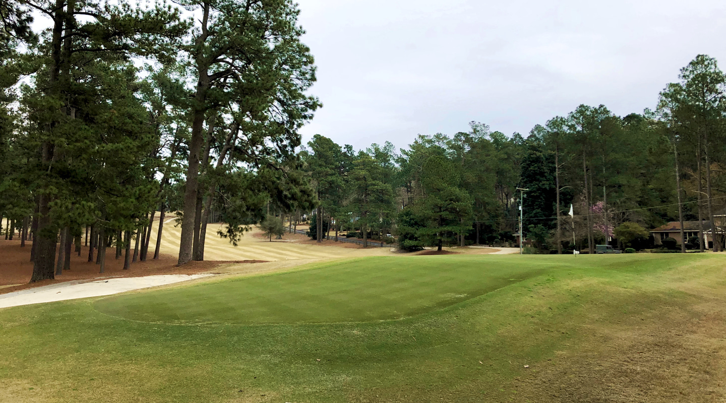 A uniquely contoured green is tucked at the end of the par-5 10th