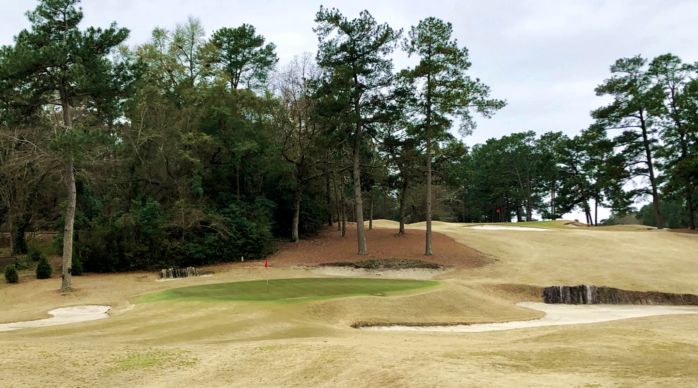 The drive on the par-4 8th is blind, with the green set at the base of the hill