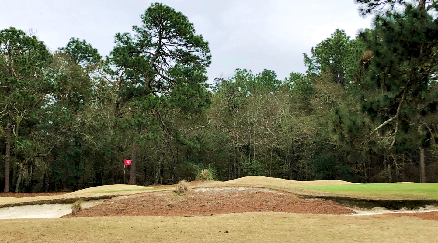 The bunkering on the uphill one-shot 9th is wonderfully naturalized