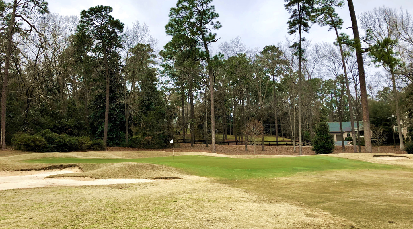 The undulating green at the 2nd is set down in a hollow