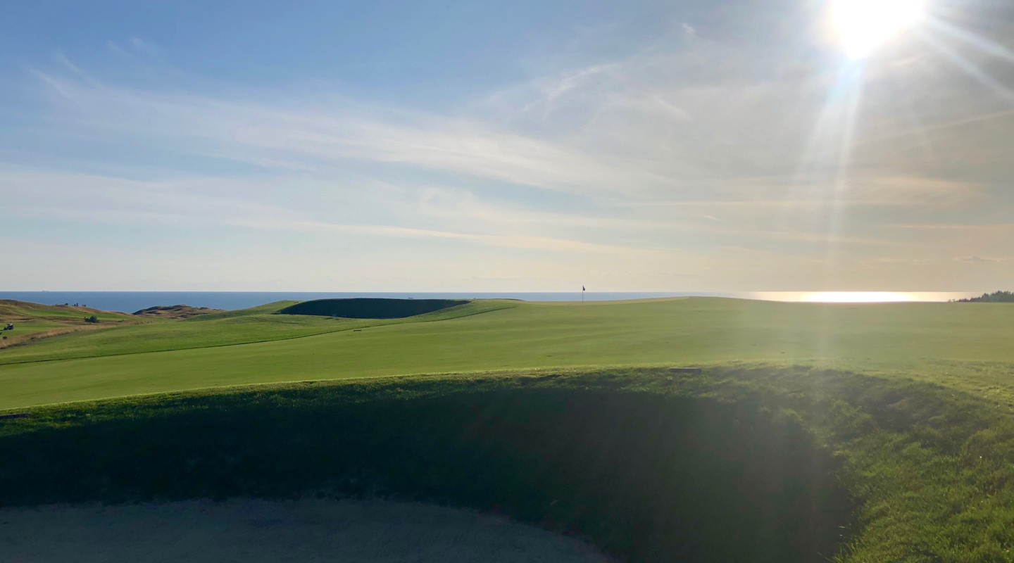 The 3rd green seems to float on the horizon