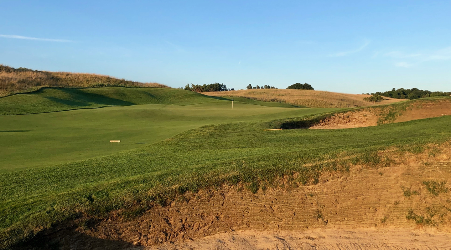 A pair of bunkers guard the approach to the green