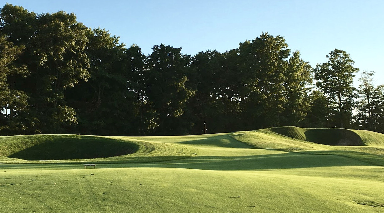 Two large revetted bunkers dictate strategy
