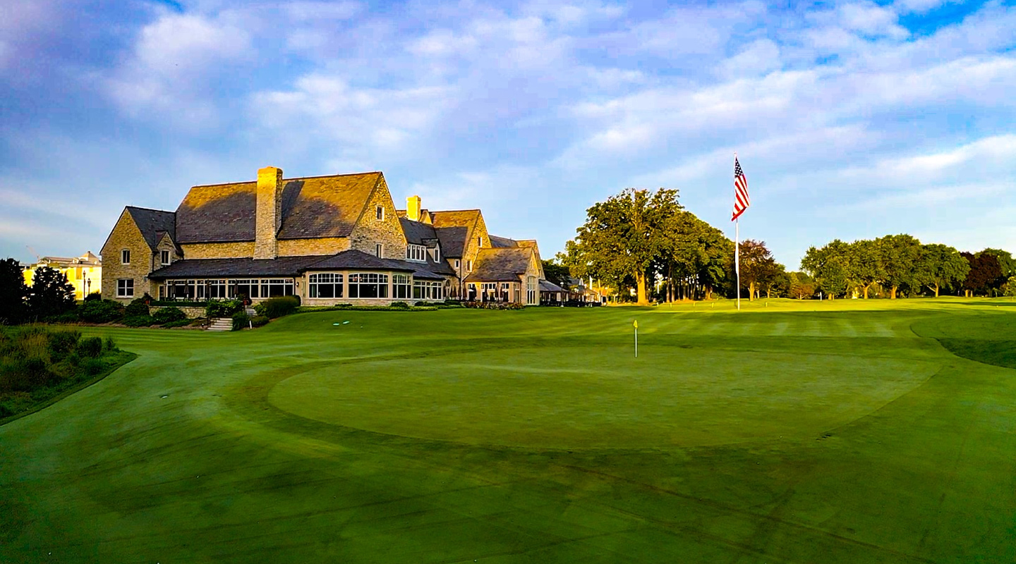 The green at the par-4 9th sits in the shadow of the stately clubhouse