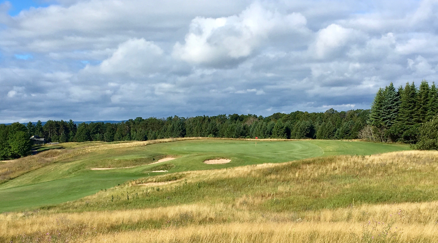 The green at this par-3 rests on a rise, exposed to the wind