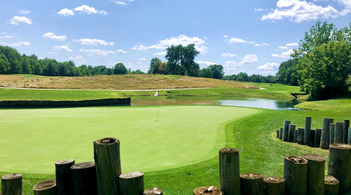 Telephone poles provide the backdrop for the 6th green