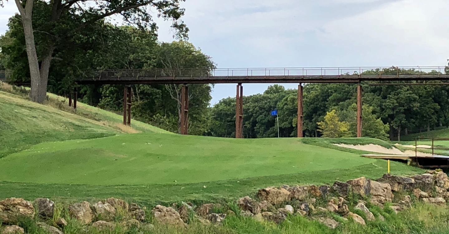 The final green is set beautifully below the bridge