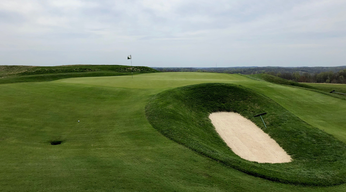 The pot bunker short of green on the par-4 10th