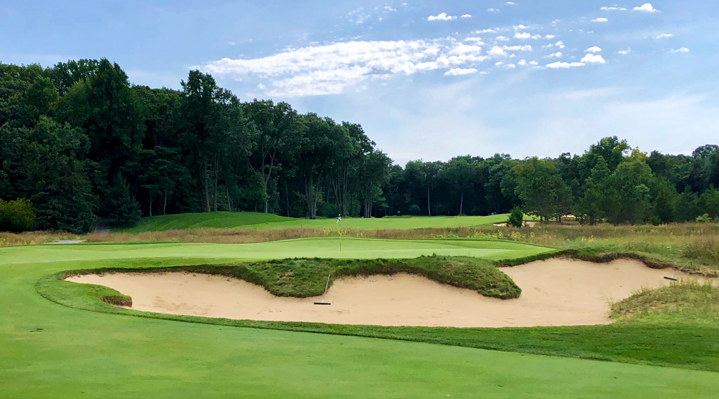 An imposing bunker fronts the green on the one-shot 5th