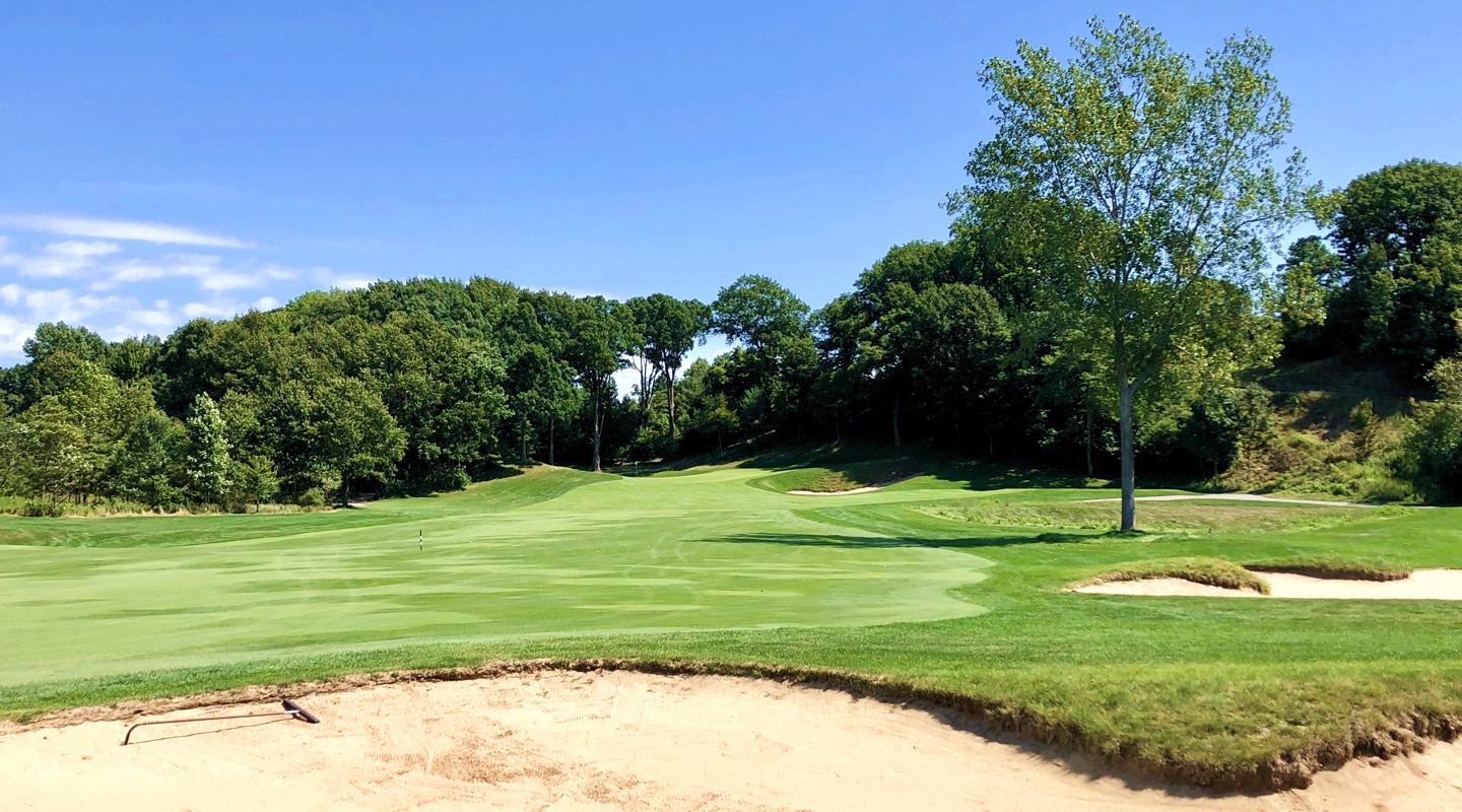 Bunkers flank the fairway on the all world par-4 11th