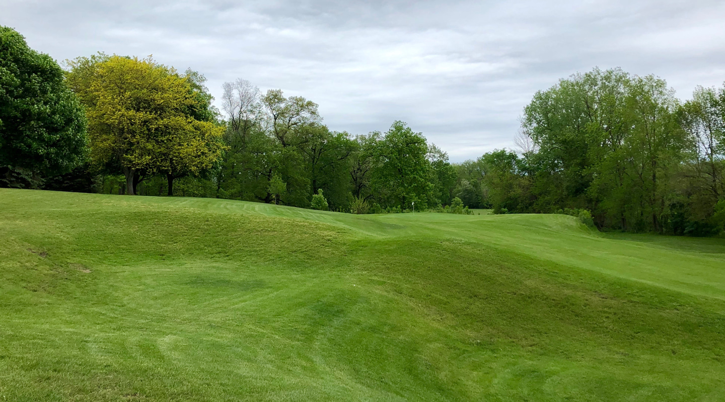 Stacked grass bunkers in the layup area on the par-5 8th