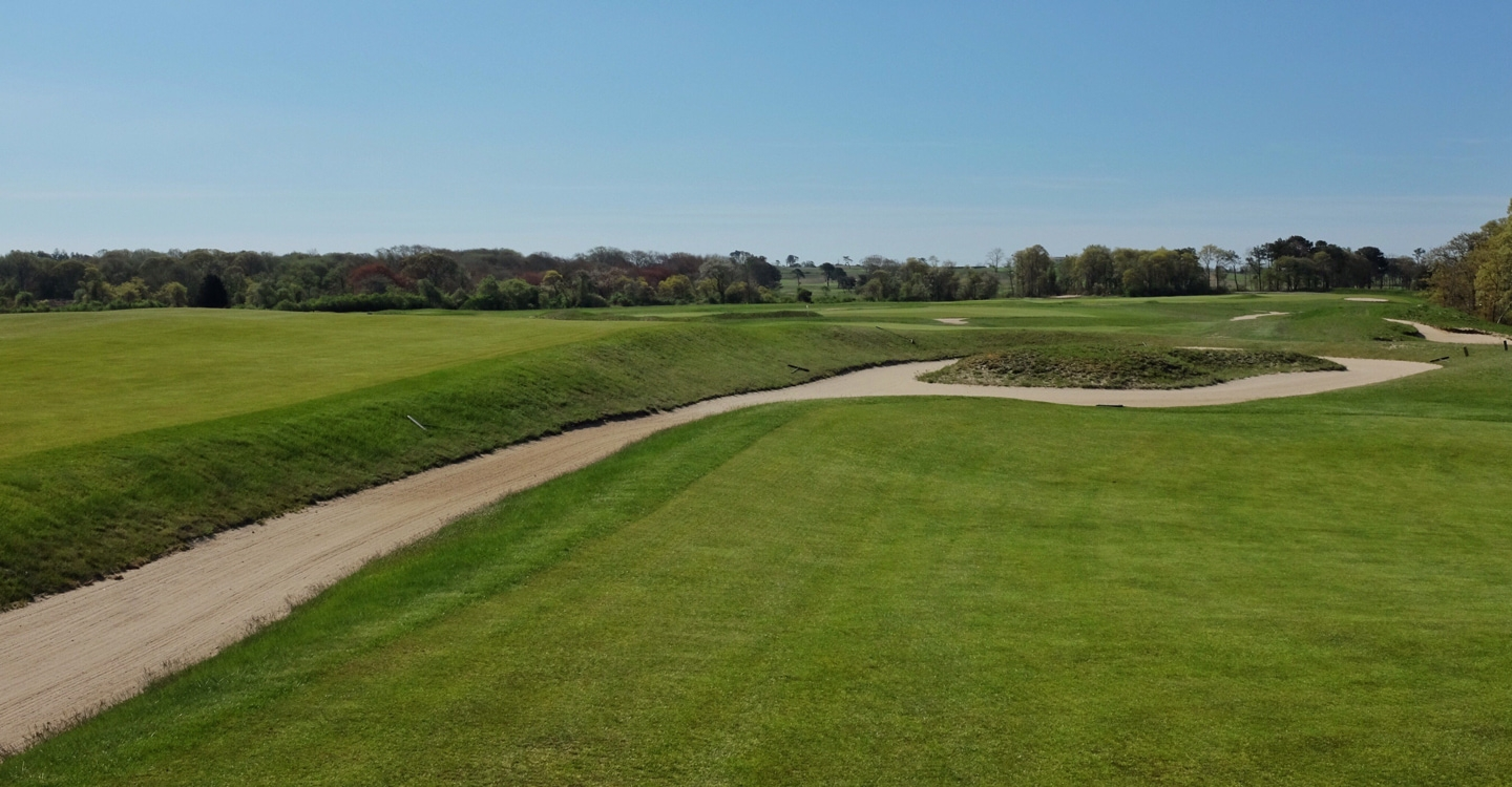 An artful Macdonald bunker juts into the middle of the fairway