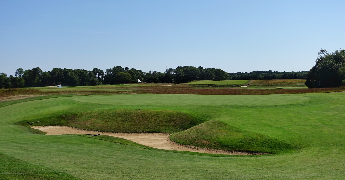 An awkward pit bunker lies in wait short of the 5th green