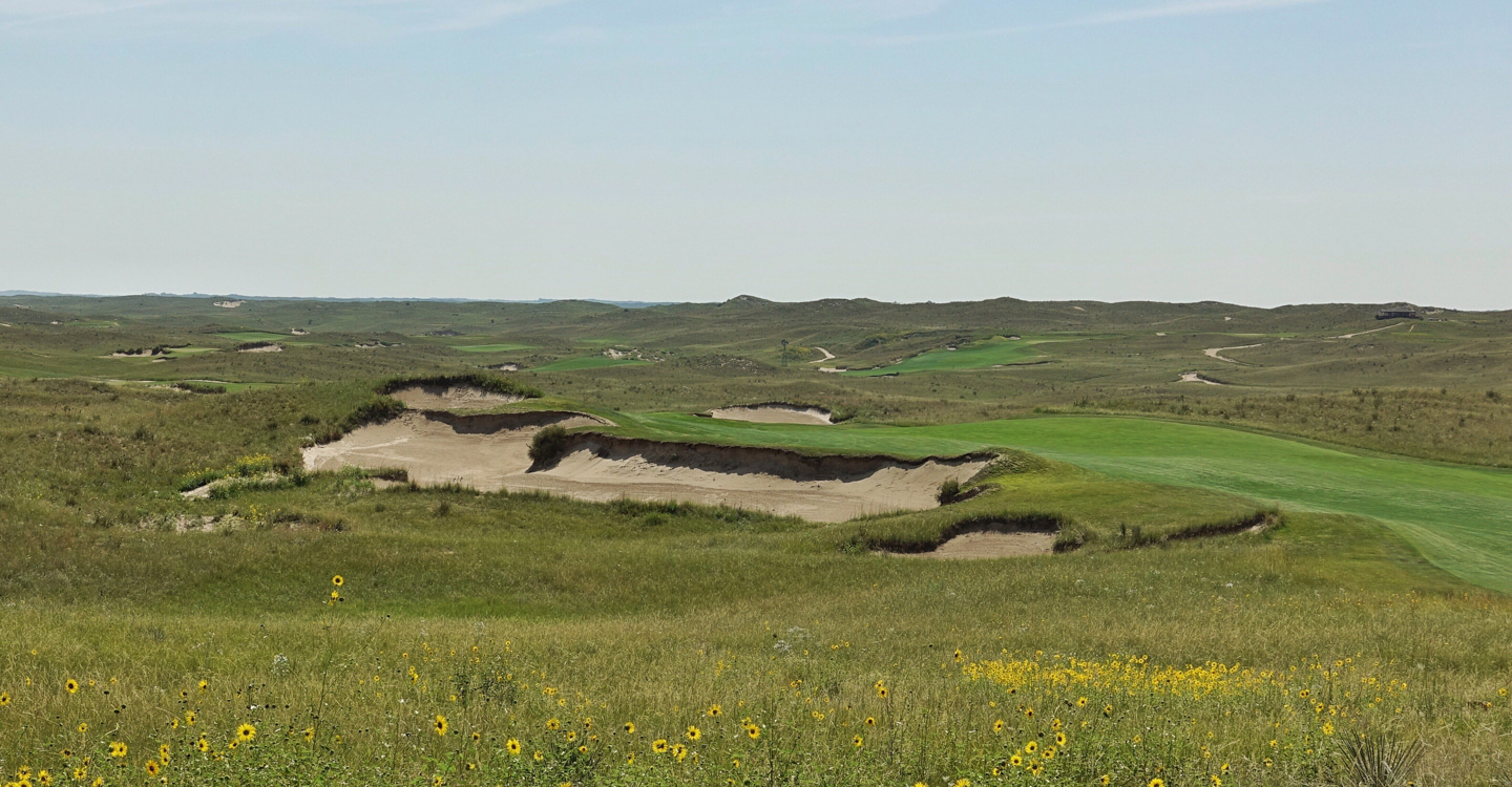 The tee shot on the 16th plays over a massive bunker