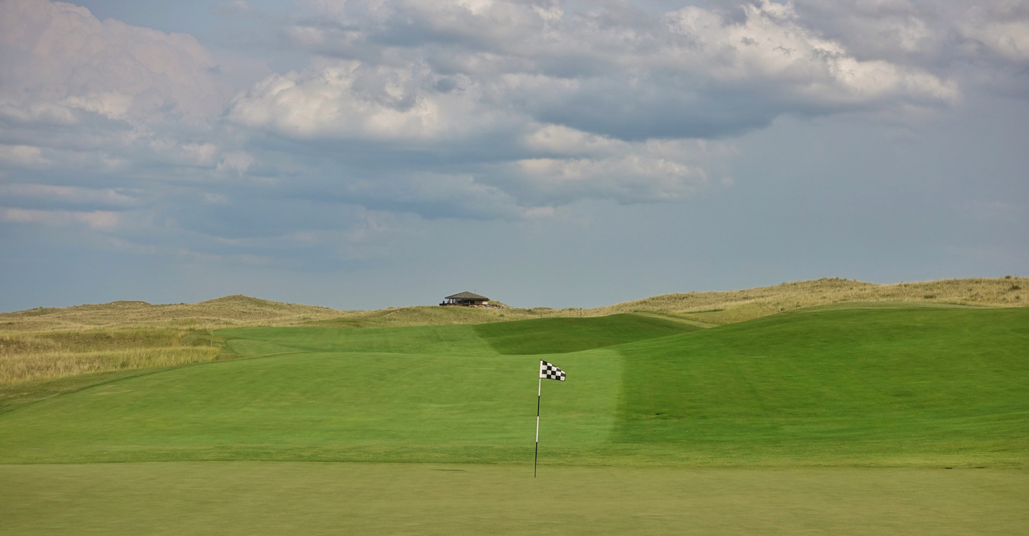 The fairway tumbles into a green which accepts running approaches